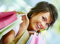 Cute young woman holding shopping bags Stock Photo
