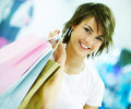 Cute young woman holding shopping bags Royalty Free Stock Images