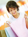 Cute young woman holding shopping bags Stock Images