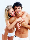 Cute young woman hugging her boyfriend from behind Stock Photography
