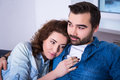 Cute young woman lying on shoulder of her boyfriend close up portrait women Royalty Free Stock Photography