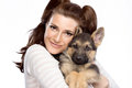 Cute young woman with a puppy dog beautiful girl tenderly hugging german shepherd portrait isolated on white Stock Photo