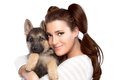 Cute young woman with a puppy dog beautiful girl tenderly hugging german shepherd portrait isolated on white Royalty Free Stock Image