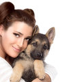 Cute young woman with a puppy dog beautiful girl tenderly hugging german shepherd portrait isolated on white copy Stock Image