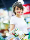 Cute young woman purchasing grocerys Stock Photos