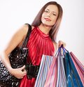 Cute young woman shopping with color bags happy isolated on white Royalty Free Stock Photography