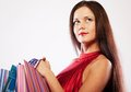 Cute young woman shopping with color bags happy on white Royalty Free Stock Images