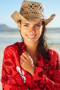 Cute young woman smiling at the beach Royalty Free Stock Photography