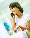 Cute young woman speaking on the mobile Royalty Free Stock Photos