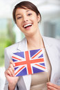 Cute young woman with United Kingdom�s flag Royalty Free Stock Photo