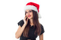 Cutie brunette girl in santa hat