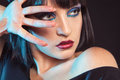 Cutie brunette in studio looking away on black background Royalty Free Stock Image