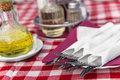 Cutlery with butter and spices on the tablecloth Royalty Free Stock Image