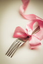 Cutlery fork with decorative ribbon close up Royalty Free Stock Photography