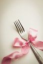 Cutlery fork with decorative ribbon close up Royalty Free Stock Image
