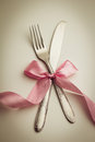 Cutlery fork and knife with decorative ribbon Stock Photo