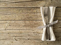 Cutlery kitchenware on old wooden boards background Royalty Free Stock Photo