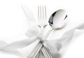 Cutlery knife spoon and fork tied ribbon Royalty Free Stock Photo