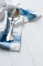 Cutlery and linen napkin vintage on a white wooden board rustic style Royalty Free Stock Images