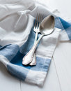 Cutlery and linen napkin vintage on a white wooden board rustic style Stock Images
