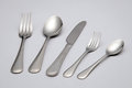 Cutlery metal knife spoons and forks with plain background Stock Images