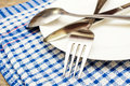 Cutlery on a plate Royalty Free Stock Photo