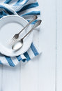 Cutlery, porcelain plate and white linen napkin Royalty Free Stock Photography