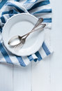 Cutlery, porcelain plate and white linen napkin Royalty Free Stock Image