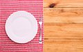 Cutlery red checkered tablecloth tartan on wooden table top view a the product page for recipes and menus cookbooks Royalty Free Stock Images