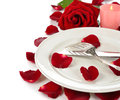 Cutlery and rose on a white background Royalty Free Stock Photo