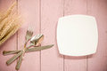 Cutlery set: knife, fork and spoons on pink wooden background Royalty Free Stock Photo