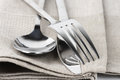 Cutlery set spoon fork and knife on linen napkin close up Royalty Free Stock Photography