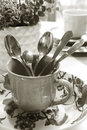 Cutlery stil life of metal in a cup black and white vertical Royalty Free Stock Photo