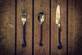 Cutlery - Vintage Fork, Spoon and Knife on Wood Background Royalty Free Stock Photo
