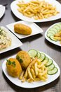 Cutlet de volaille with fries Royalty Free Stock Photo