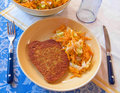 Cutlet with grated carrots. Royalty Free Stock Image