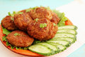 Cutlets with cucumber fried and watercress salad Royalty Free Stock Photos