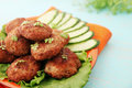 Cutlets with cucumber and watercress fried salad Royalty Free Stock Photos