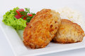 Cutlets with salad herbs and rice on a plate close up Royalty Free Stock Image