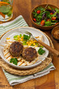 Cutlets or sausage patties homemade skewers for dinner selective focus Stock Photo