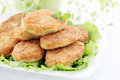 Cutlets with thyme large fried and lettuce Stock Image