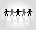 Cutout paper people holding hands Royalty Free Stock Photos