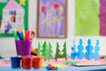 Cutouts and painting colourful pens paints in a kindergarden Royalty Free Stock Photo