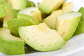Cutted avocado on plate closeup Royalty Free Stock Photography