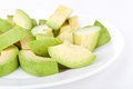 Cutted avocado on white plate Royalty Free Stock Image