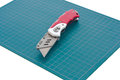 Cutter and cutting mat cut paper or everything by it s very sharp dangerous use with for protect your floor or desk Royalty Free Stock Photography