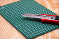Cutter on green cutting mat Royalty Free Stock Photo