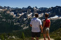 Cutthroat pass north cascades national park a couple enjoy the view from trail in Royalty Free Stock Image