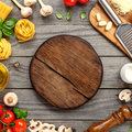 Cutting board with copy space with ingredients for cooking pasta Royalty Free Stock Photo