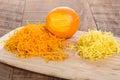 Cutting board with orange zest and lemon Stock Image